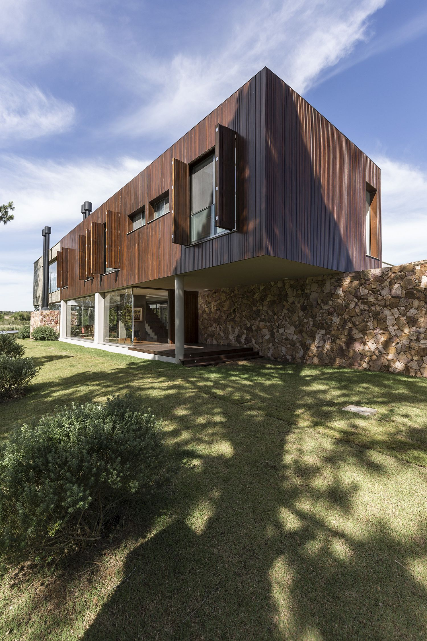Concrete cantilevers, wood and natural stone create a goregous contemporary home