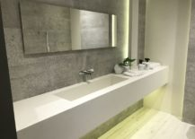 Concrete-inspired-wall-tiles-with-white-large-bathroom-sink-by-Porcelanosa-217x155