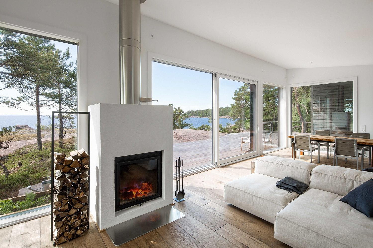 Contemporary fireplace in the living room with a stylish log storage area