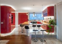 Contemporary-kitchen-in-red-and-white-with-dazzling-LED-lighting-217x155