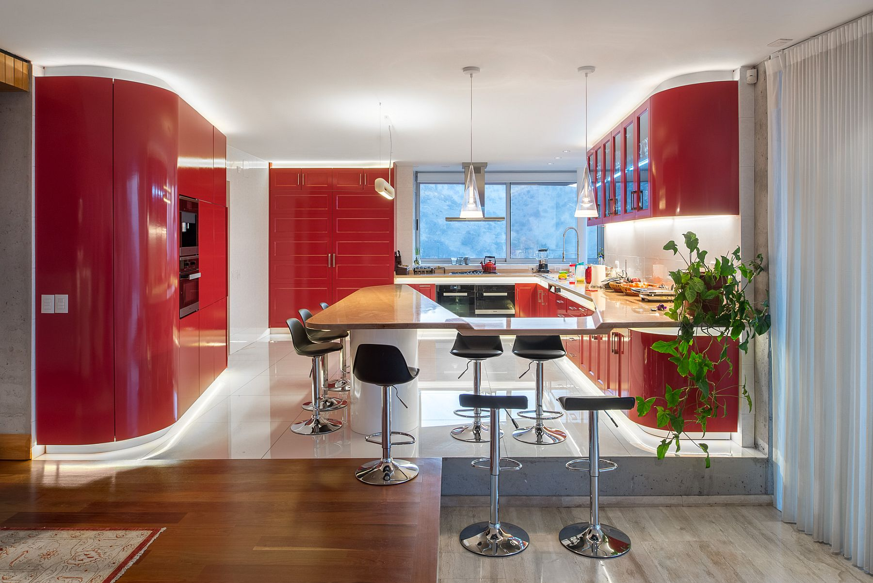 Contemporary kitchen in red and white with dazzling LED lighting