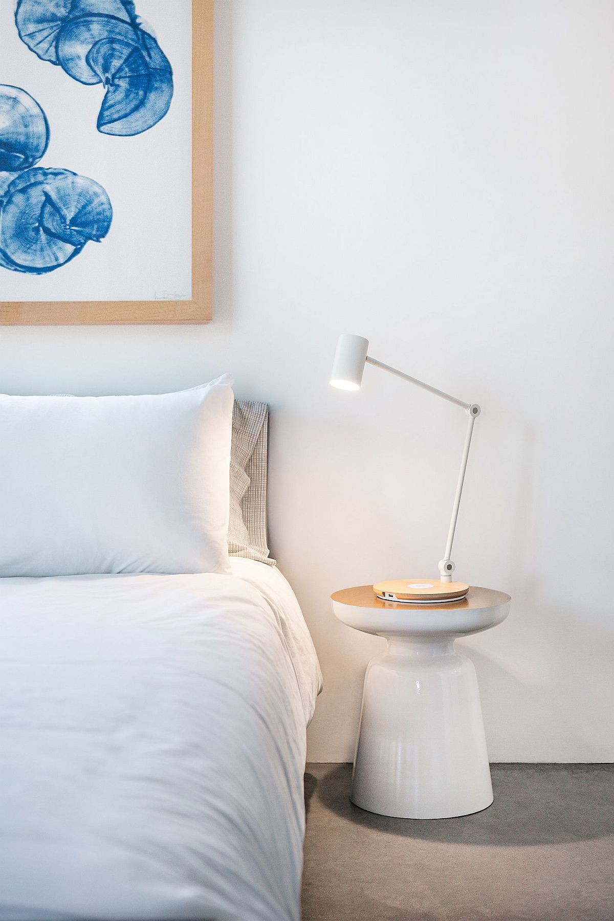 Contemporary side table in white from West Elm along with a cool table lamp