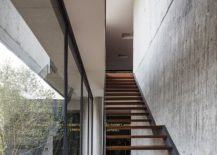 Contemporary-wooden-stairway-with-concrete-wall-next-to-it-217x155