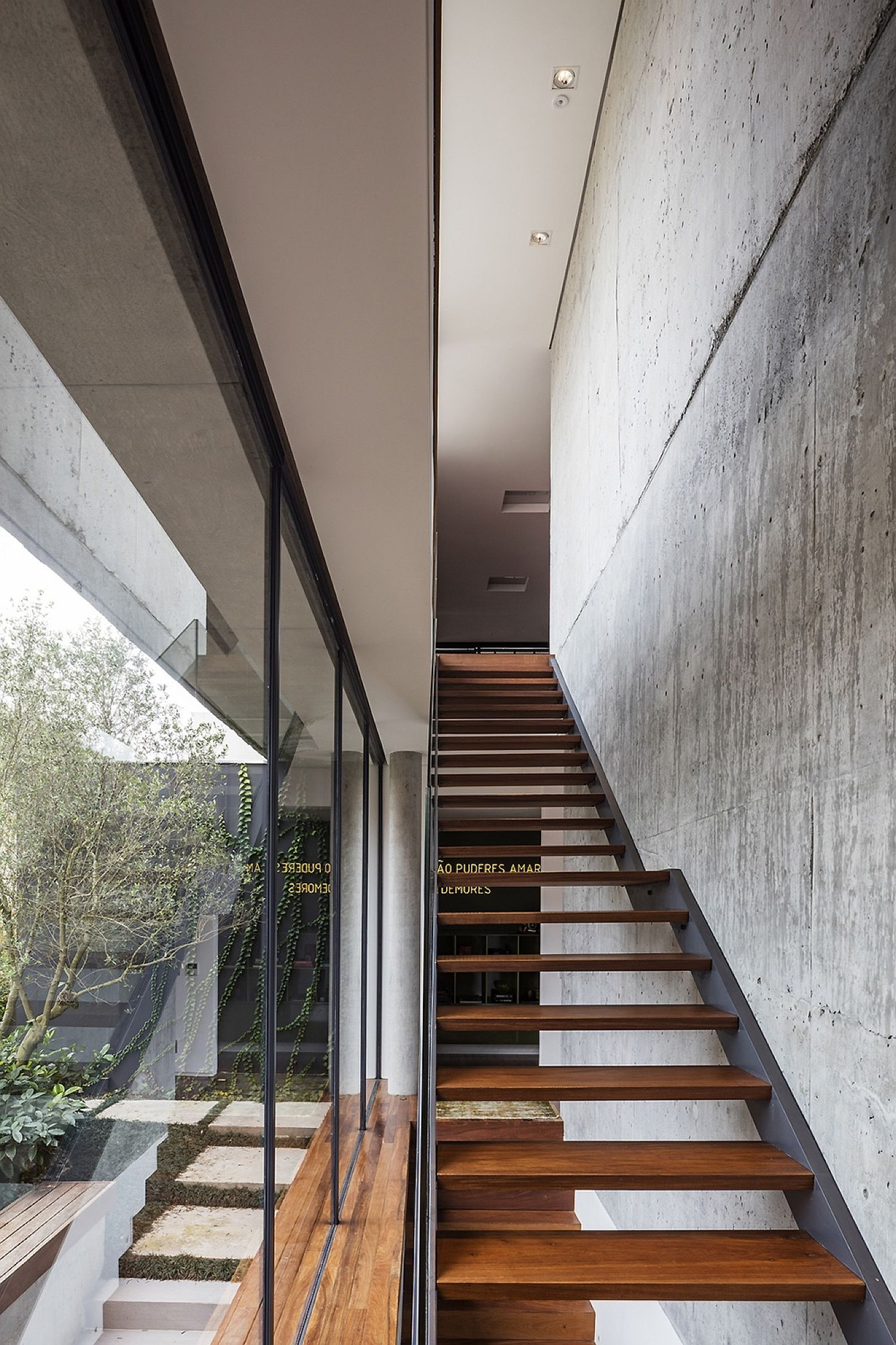 Contemporary-wooden-stairway-with-concrete-wall-next-to-it