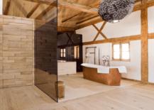 Copper-bathtub-as-a-focal-point-in-a-vast-bathroom-217x155