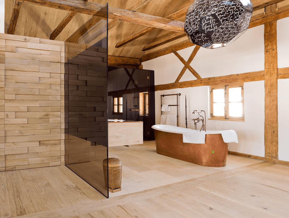 Copper bathtub as a focal point in a vast bathroom