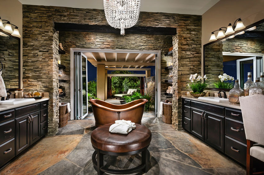 Copper bathtub is a great contrast to the dark wood interior