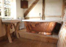 Copper-bathtub-with-a-raw-look-217x155