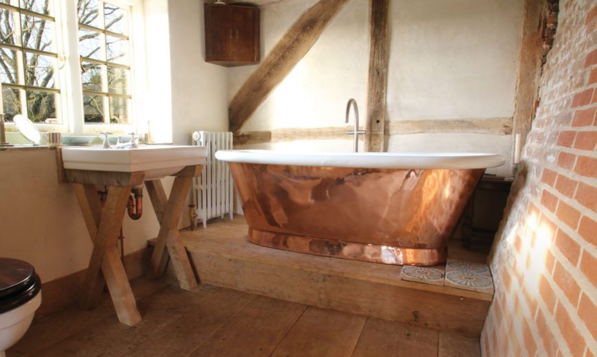 16 Copper Bathtubs That Completely Reinvent The Space