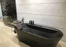 Dark-stone-bath-tub-with-wood-looking-floor-tiles-by-Porcelanosa-217x155