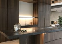 Dark-wood-inspired-ceramics-for-kitchen-cabinets-by-Porcelanosa-217x155