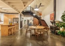 Dining-area-and-kitchen-of-the-renovated-warehouse-residence-embrace-wood-217x155