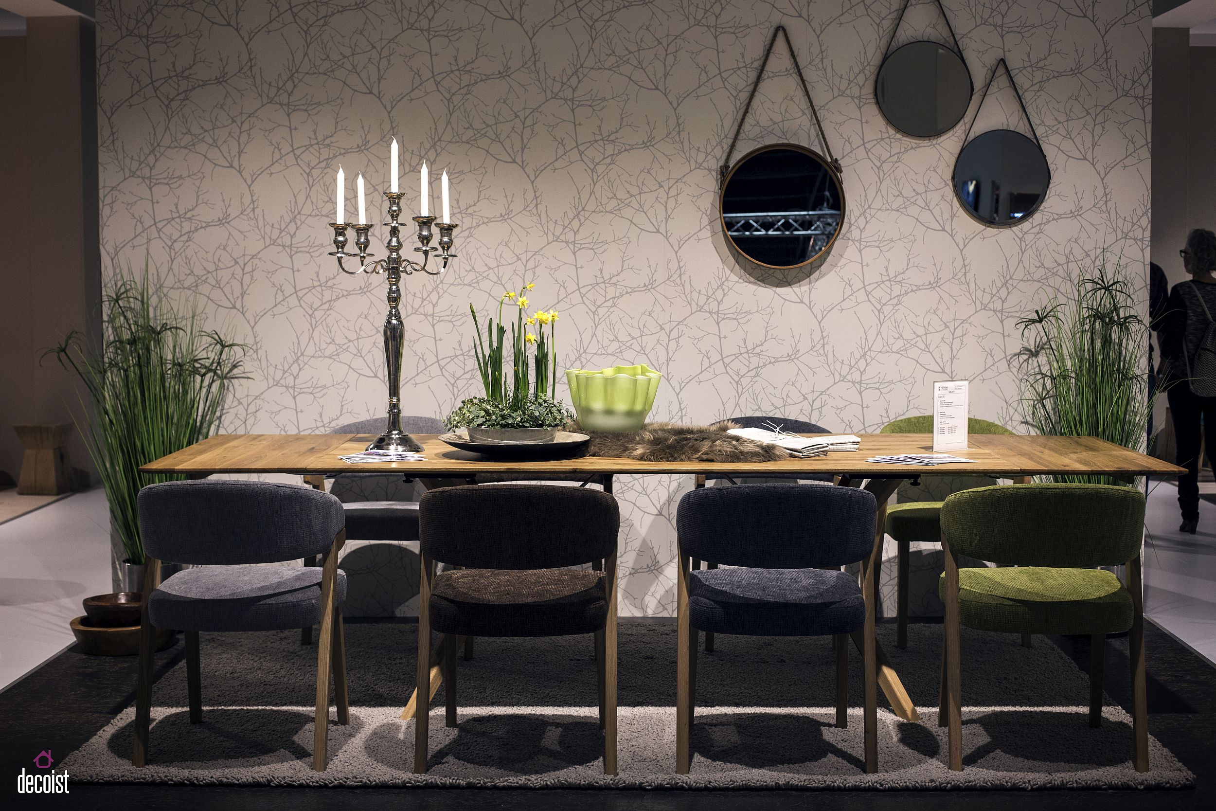 Dining room with wooden dining table, fabulous mirrors and a dashing backdrop