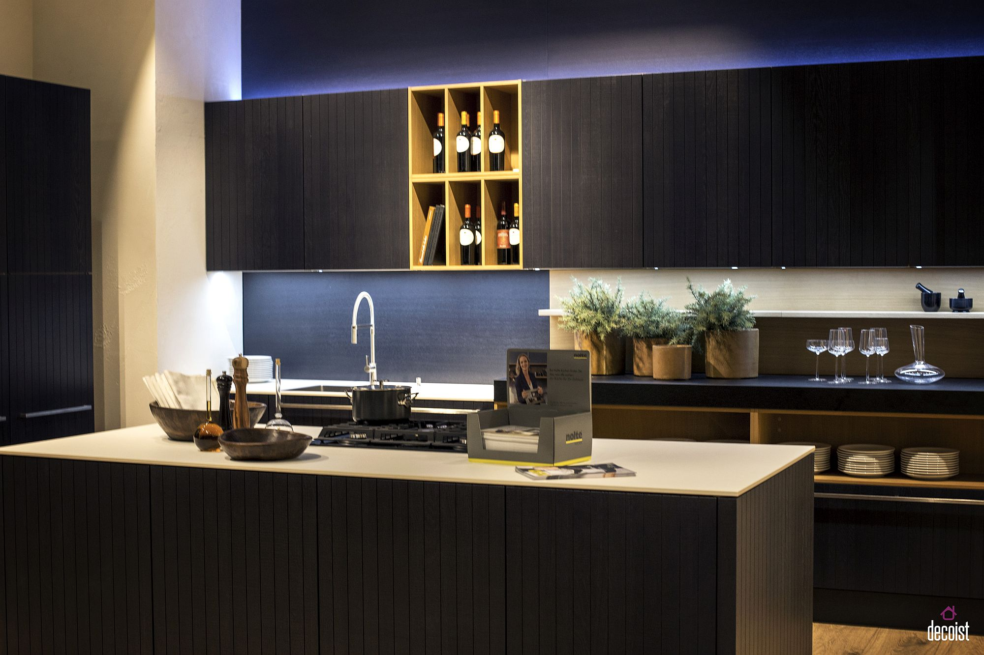 Elegant wooden finish for the cabinets and the island gives the kitchen a curated appeal