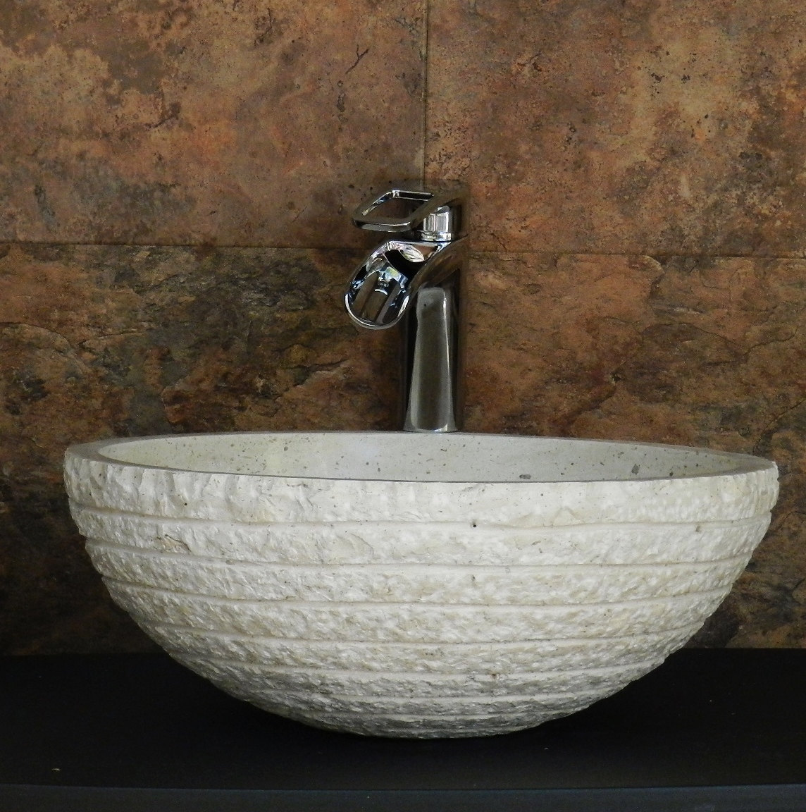 vessel sink that looks almost as a pure stone without much