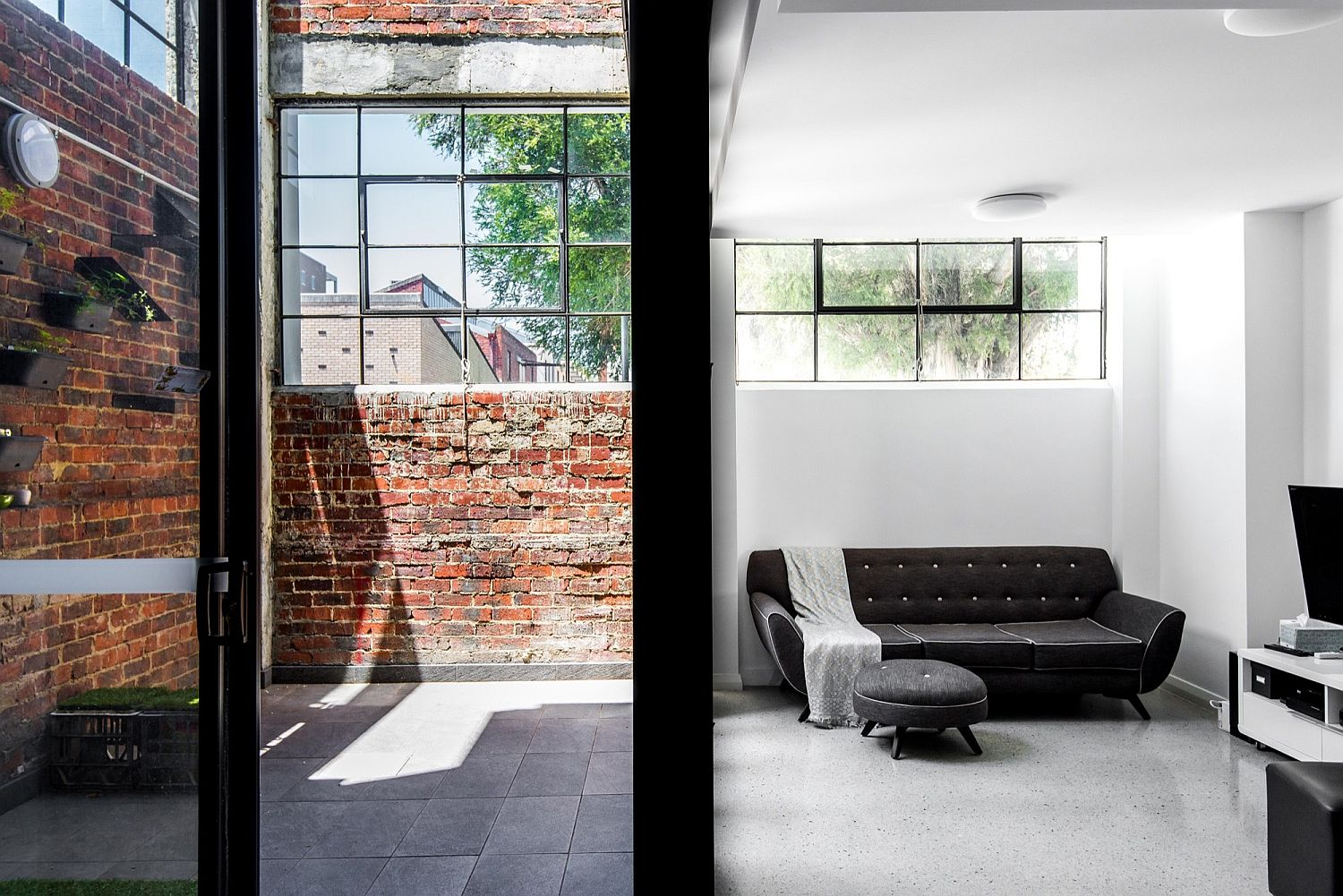 Exposed brick wall sections and windows preserve the classic appeal of the building