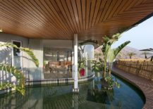 Exquisite-wooden-deck-and-reflecting-pond-around-the-Chilean-home-help-regulate-temperature-217x155