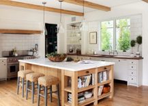Farmhouse style kitchen with gorgeous island in wood and a marble coutertop 217x155 10 Dashing Modern Kitchens that Combine Marble and Wood
