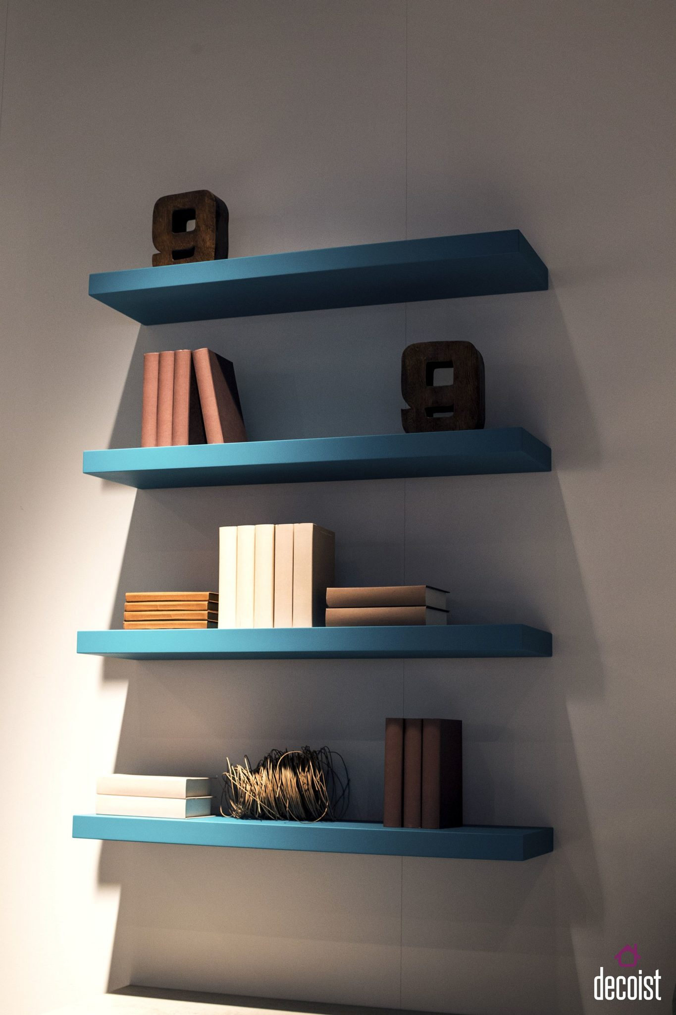Floating shelves add a touch of turquoise to the interior