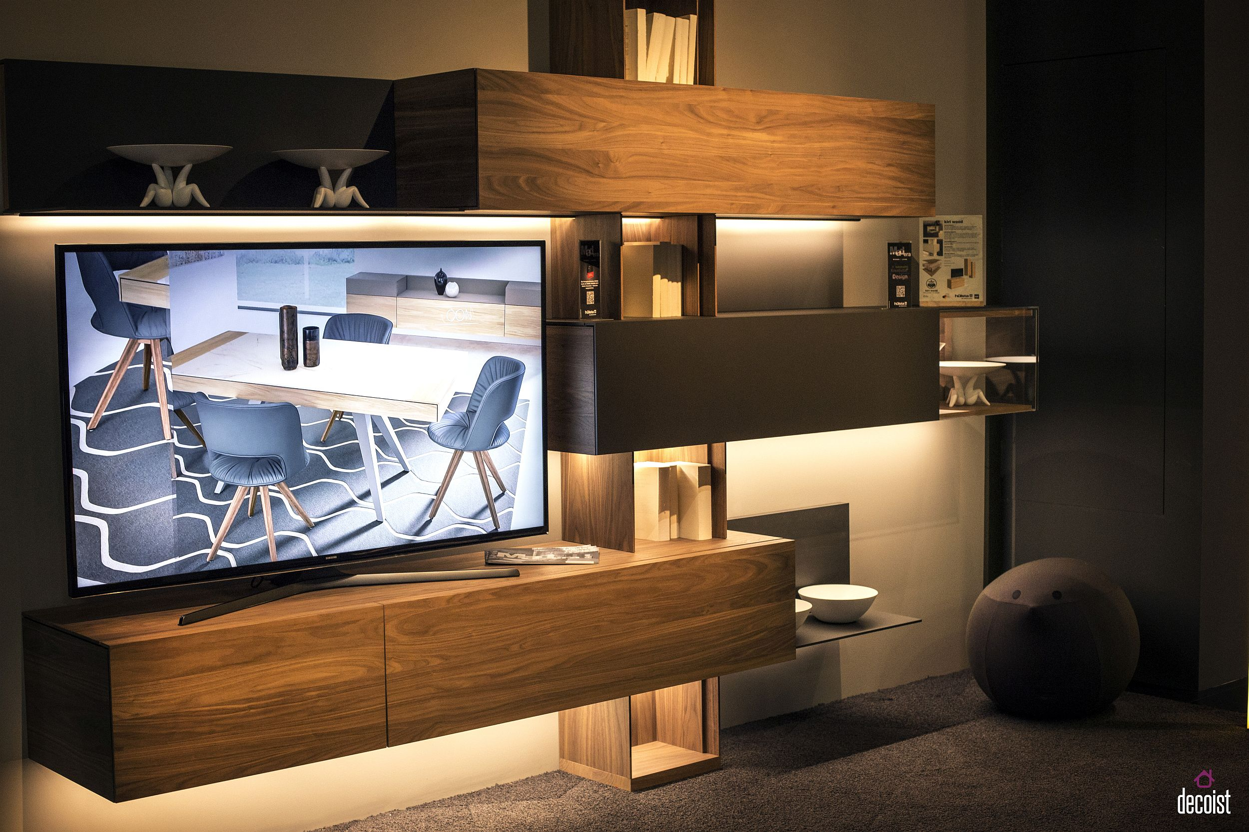 Floating wooden cabinets with LED under-cabinet lighting make for scintillating TV stands