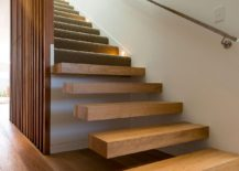 Floating-wooden-staircase-with-wooden-slats-inisde-the-contemporary-home-217x155