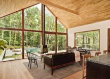 Gabled-roof-and-wall-of-glass-gives-the-home-a-modern-midcentury-vibe-217x155