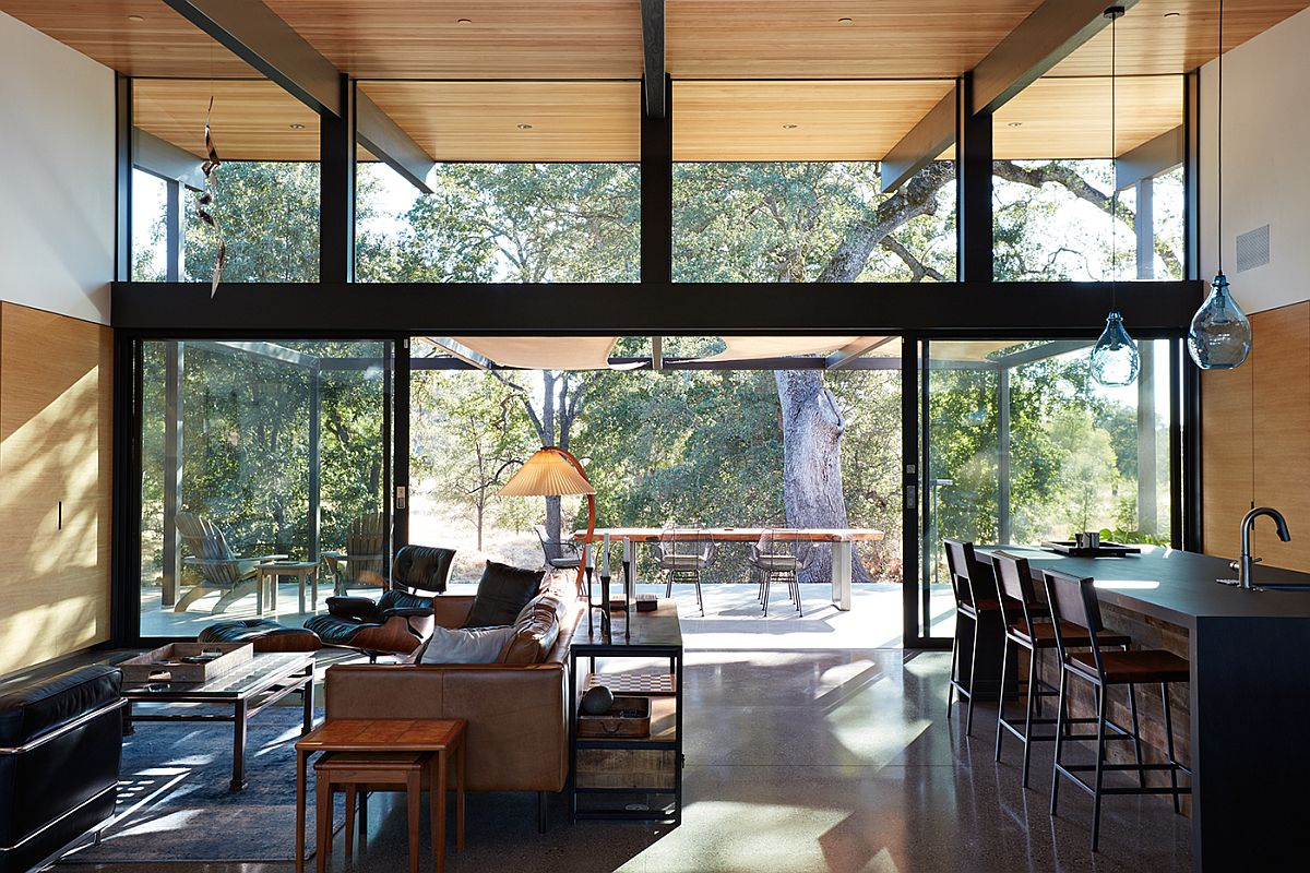 Glass walls and doors connect the living area with the landscape outside
