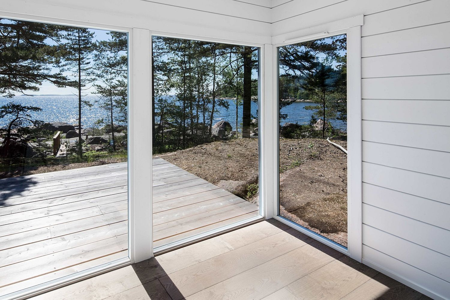 Glittering sea views and a rocky shore surround the serene Summer House