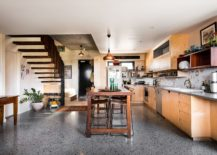 Gorgeous copper pendant lighting for the kitchen island 217x155 Smart Spatial Design: Nifty Apartment Units Find Space Inside Heritage Building