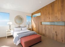 Gorgeous-wooden-accent-wall-with-cutouts-for-the-bedroom-in-white-with-beach-view-217x155