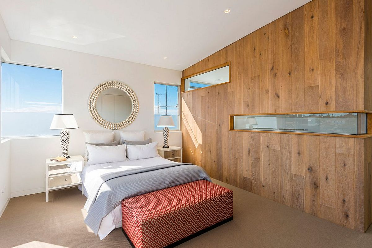 Gorgeous-wooden-accent-wall-with-cutouts-for-the-bedroom-in-white-with-beach-view