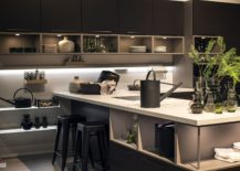 Gray-kitchen-island-with-white-countertop-and-a-dashing-dark-backdrop-217x155