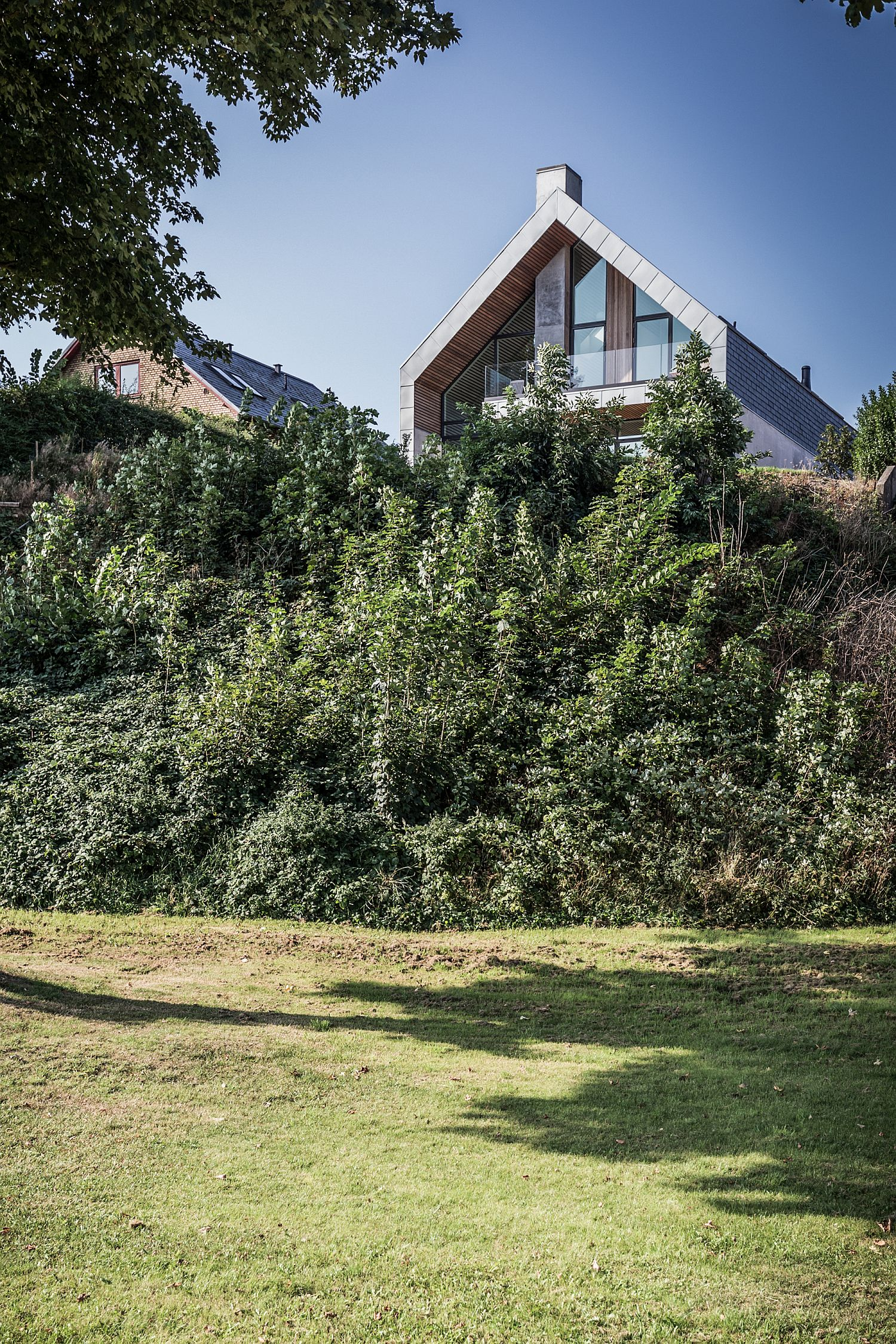 Green vegetation around the Denmark home creates a natural blanket offering privacy