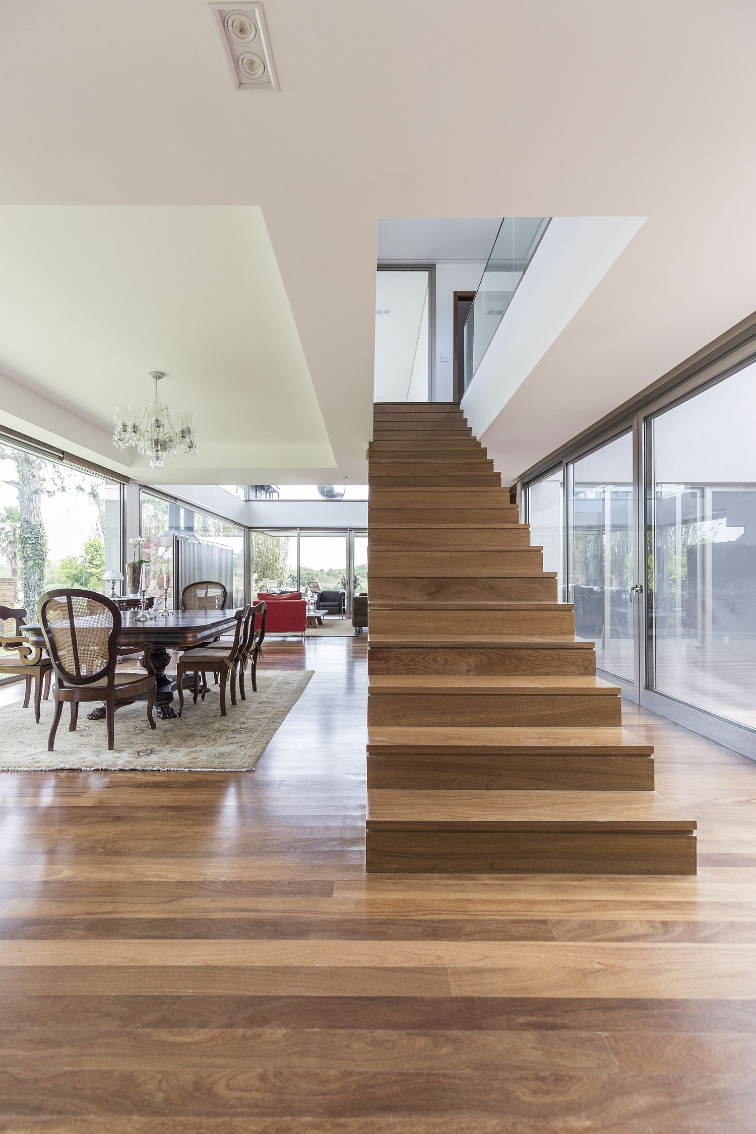 Ingenious staircase design also brings natural light into the lower level of the home