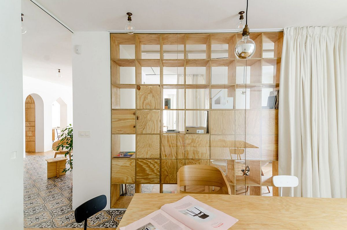 Ingenious wooden partitions create visual connectivity between various workzones
