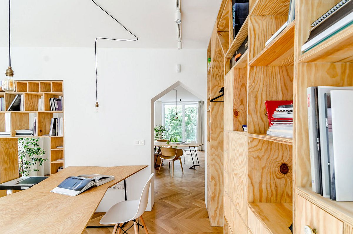 Innovative apartment studio with wooden desk and chevron pattern flooring