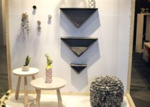 Inverted-triangle-shaped-shelves-add-geo-contrast-to-the-interior-217x155