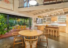 Kitchen-and-dining-space-clad-in-wood-flow-into-the-alfresco-dining-and-terrace-217x155