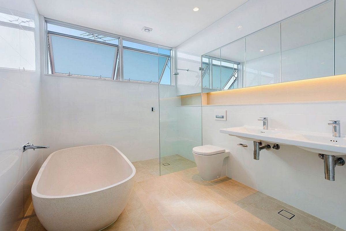 LED-strip-lighting-adds-charm-to-the-stylish-contemporary-bathroom-in-white