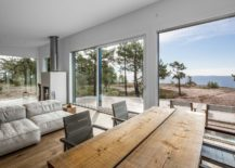 Large-floor-to-ceiling-glass-windows-and-a-modern-interior-create-relaxing-ambiance-at-the-island-retreat-217x155