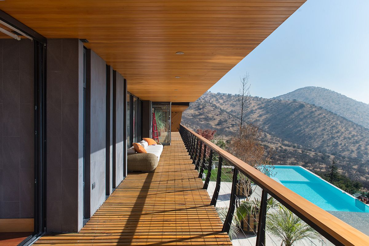 Lavish deck of the top level overlooks the infinity pool and the view beyond