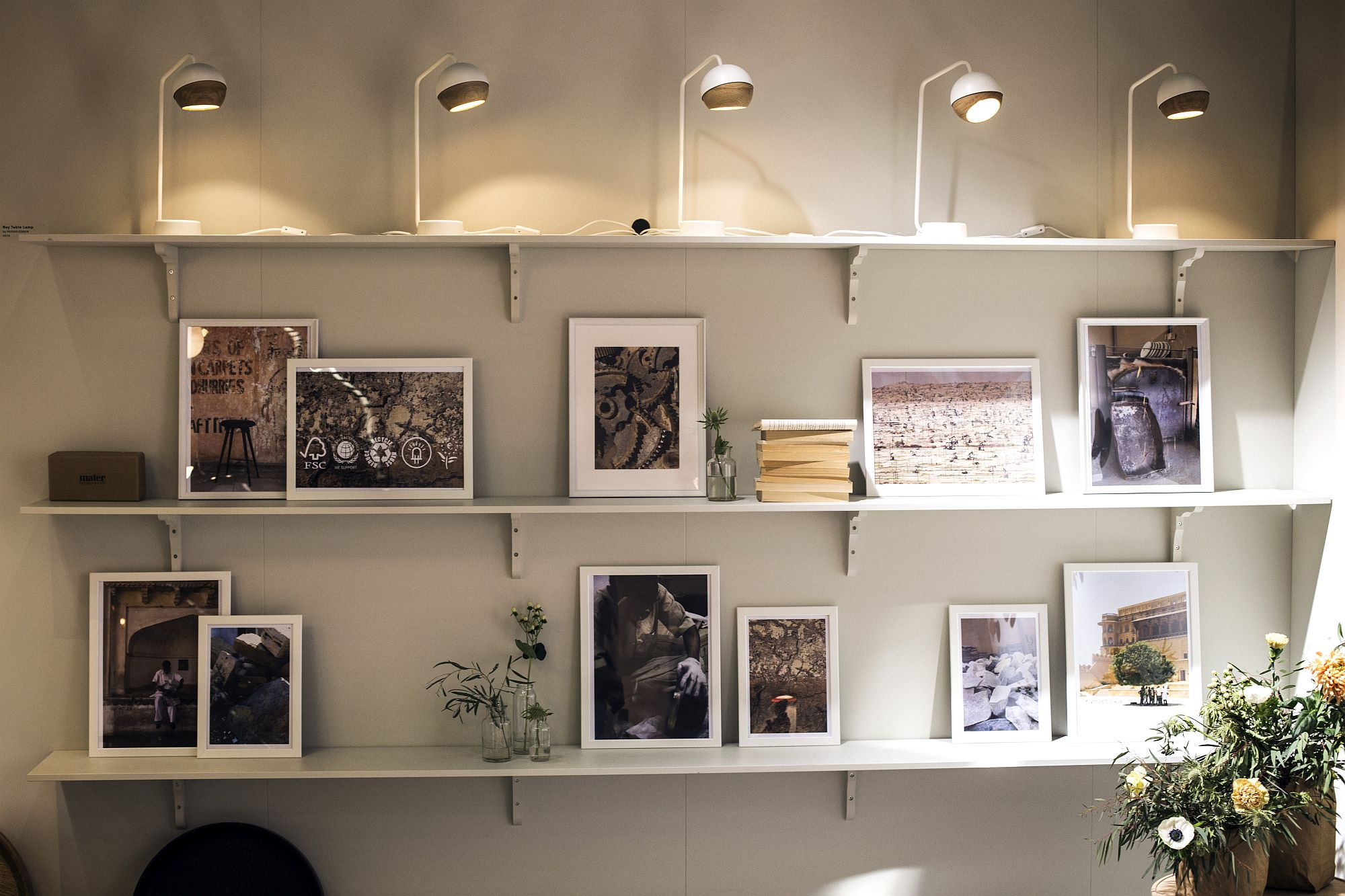Lighting adds to the beauty and simplicity of the floating shelves in white
