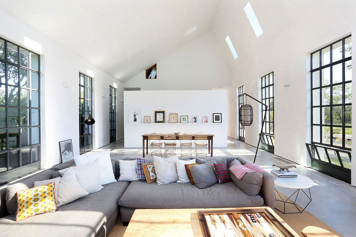 Living and dining room in white with slanted ceiling