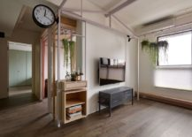 Living space with minimal decor and greenery 217x155 Fashion Designer's Hub in Taiwan Relies on Smart Shelving and Storage