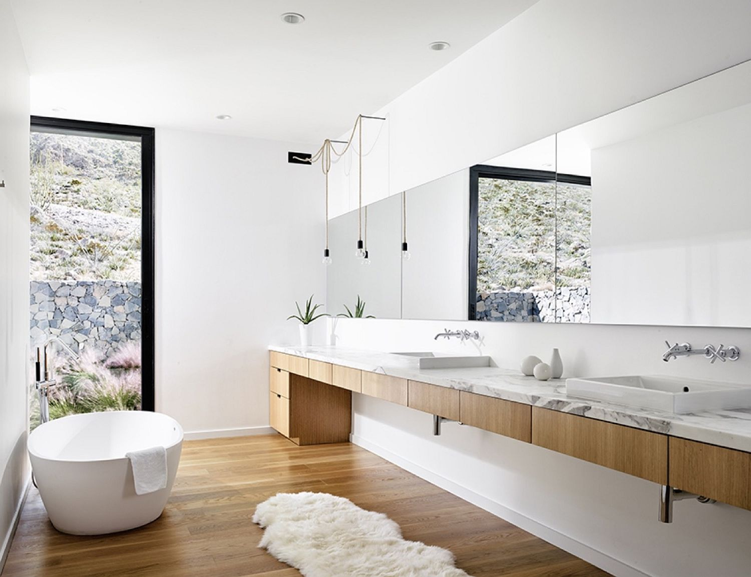Long wooden vanity in the bathroom with marble top