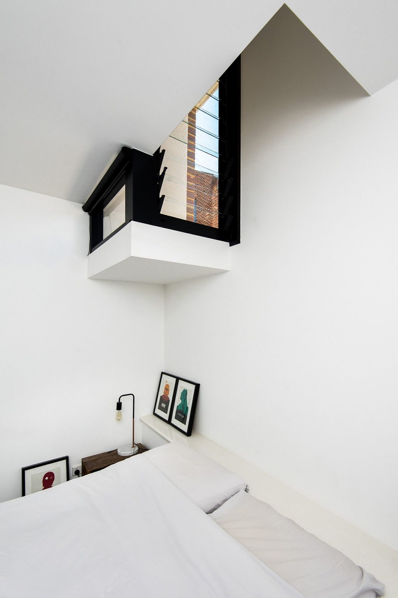 Lower level bedroom with periscope window of the living space