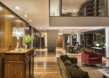 Mezzanine-level-with-glass-wall-overlooks-the-lower-living-area-217x155