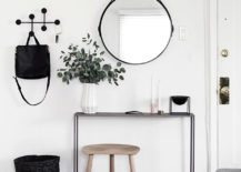 Minimalist-entryway-decorated-in-black-white-and-wood-217x155