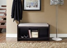 Minimalist-entryway-with-a-a-short-little-bench-and-a-decorative-lamp--217x155