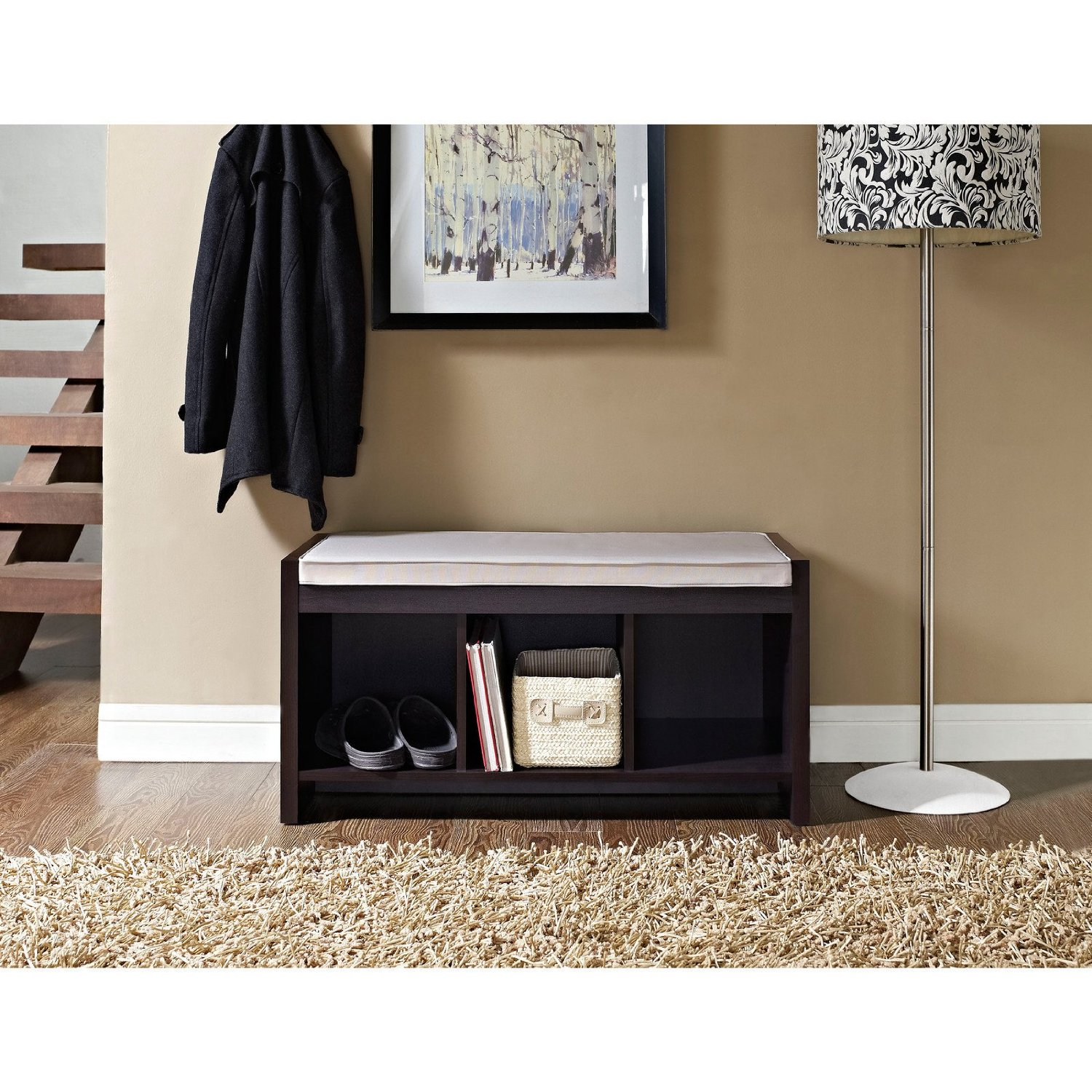 Minimalist-entryway-with-a-a-short-little-bench-and-a-decorative-lamp-